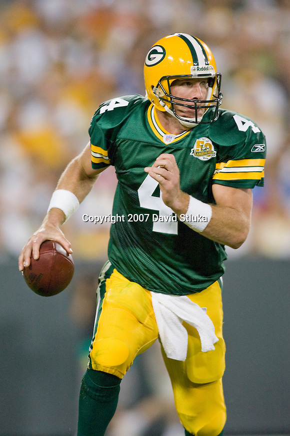 Quarterback Brett Favre #4 of the Green Bay Packers looks for a receiver during an NFL football game against the Chicago Bears at Lambeau Field on October 7, 2007 in Green Bay, Wisconsin. The Bears beat the Packers 27-20. (Photo by David Stluka)