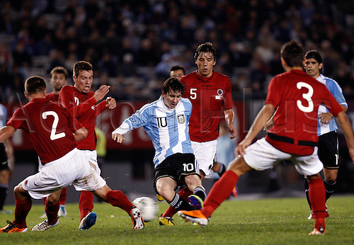 20.06.2011 Argentina's Lionel Messi (C) shoots during the friendly football match against Albania at the Monumental stadium in Buenos Aires on June 20, 2011. Argentina won 4-0.
