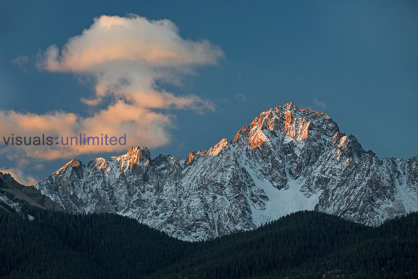 Mount Sneffels (14,150 ft - 4313 m) in the Sneffels Wilderness of Colorado, USA is lit by the warm glow of sunrise