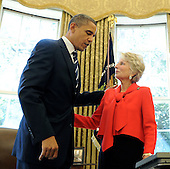 """United States President Barack Obama speaks with United States Representative Jane Harman (Democrat of California) after signing the """"Reducing Over Classification Bill"""" in the Oval Office of the White House in Washington on Thursday, October 7, 2010.  .Credit: Roger L. Wollenberg - Pool via CNP"""