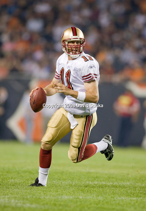 Quarterback Alex Smith #11 of the San Francisco 49ers looks for a receiver against the Chicago Bears at Soldier Field on August 21, 2008 in Chicago, Illinois. The 49ers defeated the Bears 37-30. (AP Photo/David Stluka)