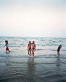 ERITREA, Hamasien, Eritrean twins play and swim in the Red Sea