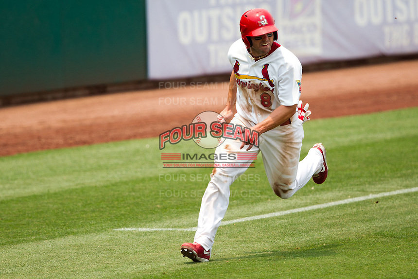 Chris Swauger (8) of the Springfield Cardinals rounds third base during a game against the Tulsa Drillers at Hammons Field on June 27, 2011 in Springfield, Missouri. (David Welker / Four Seam Images)