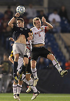 HOOVER, AL - DECEMBER 07, 2012:  Helge Leikvang (6) of the University of Maryland goes up for a header with Steve Neumann (18) of Georgetown University during an NCAA 2012 Men's College Cup semi-final match, at Regents Park, in Hoover , AL, on Friday, December 07, 2012. The game ended in a 4-4 tie, after overtime Georgetown won on penalty kicks.