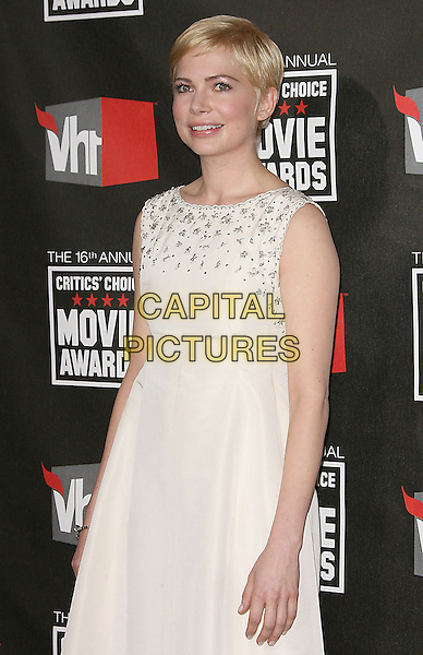 MICHELLE WILLIAMS .at The16th Annual Critics' Choice Movie Awards held at The Hollywood Palladium in Hollywood, California, USA, January 14th, 2011..half length sleeveless white dress cream beaded neckline trim .CAP/RKE/DVS.©DVS/RockinExposures/Capital Pictures.