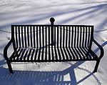Empty park bench on capitol square in Madison, Wisconsin.
