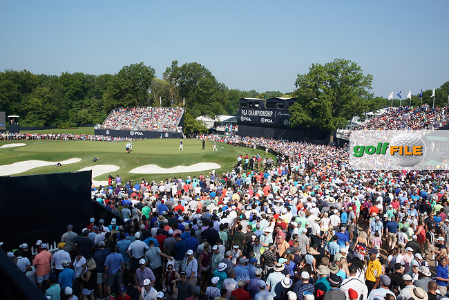 Fans watch Tiger Woods (USA) and Justin Thomas (USA) and Rory McIlroy (NIR) putt on the 18th hole during the second round of the 100th PGA Championship at Bellerive Country Club, St. Louis, Missouri, USA. 8/11/2018.<br /> Picture: Golffile.ie | Brian Spurlock<br /> <br /> All photo usage must carry mandatory copyright credit (© Golffile | Brian Spurlock)