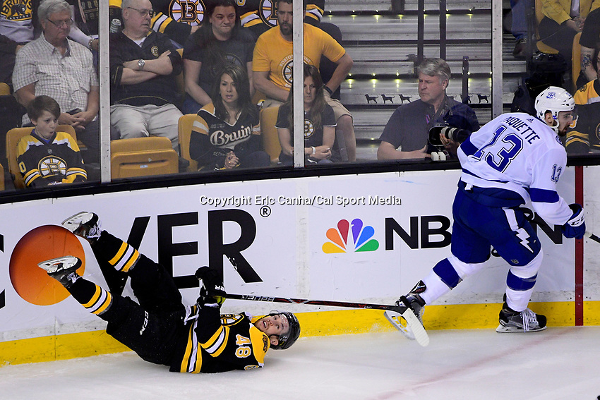 May 2, 2018: Boston Bruins defenseman Matt Grzelcyk (48) gets checked by Tampa Bay Lightning center Cedric Paquette (13) during game three of the second round of the National Hockey League's Eastern Conference Stanley Cup playoffs between the Tampa Bay Lightning and the Boston Bruins held at TD Garden, in Boston, Mass. Tampa Bay defeats Boston 4-1. Eric Canha/CSM
