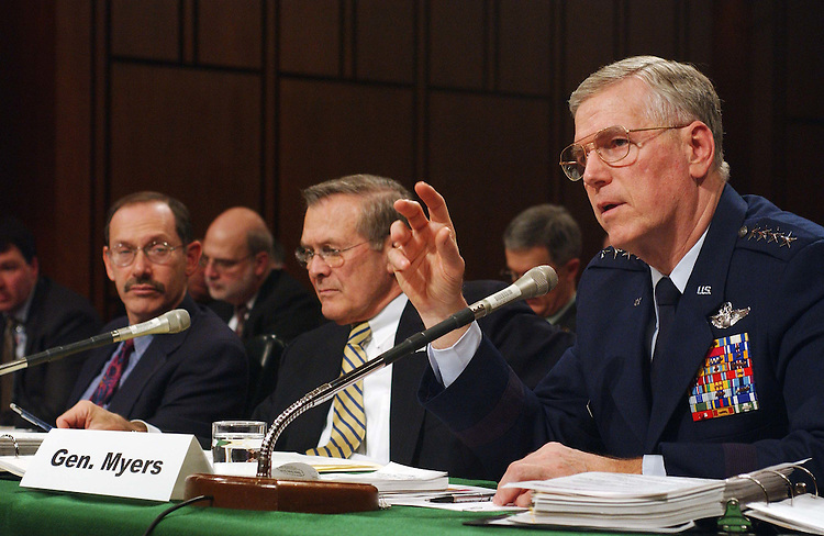 2/13/03.DEFENSE AUTHORIZATION REQUEST--Dr. Dov Zakheim, Defense Department comptroller, Defense Secretary Donald H. Rumsfeld and Gen. Richard B. Myers, USAF chairman of the Joint Chiefs of Staff, during the Senate Armed Services hearing on the defense authorization request for Fiscal Year 2004 and on the defense program of the future..CONGRESSIONAL QUARTERLY PHOTO BY SCOTT J. FERRELL