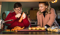 FAO: Society <br /> Pictured: Alys Phillips (R) peeling vegetables for lunch with resident Sharon Wieland<br /> Re: Care worker Alys Phillips, 23, who looks after people with learning disabilities in Brecon, mid Wales, UK. Wednesday 01 February 2017