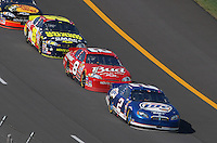 Apr 29, 2007; Talladega, AL, USA; Nascar Nextel Cup Series driver Kyle Busch (2) leads Dale Earnhardt Jr (8) and Casey Mears (25) during the Aarons 499 at Talladega Superspeedway. Mandatory Credit: Mark J. Rebilas