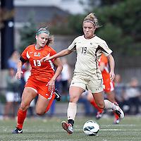 Boston College midfielder Kristen Mewis (19) passes the ball. .After two overtime periods, Boston College (gold) tied University of Miami (orange), 0-0, at Newton Campus Field, October 21, 2012.