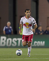 New York Red Bulls defender Rafa Marquez (4) brings the ball forward. In a Major League Soccer (MLS) match, the New England Revolution tied New York Red Bulls, 2-2, at Gillette Stadium on August 20, 2011.