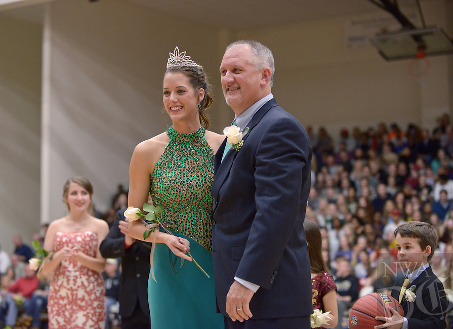 NWA Democrat-Gazette/BEN GOFF @NWABENGOFF<br /> Madison Brittain and father Mark Brittain pose after Madison was named Bentonville High Colors Day Queen on Friday Jan. 15, 2016 during Bentonville High's colors day ceremony at halftime in the boys basketball game against Springdale Har-Ber in Bentonville's Tiger Arena.