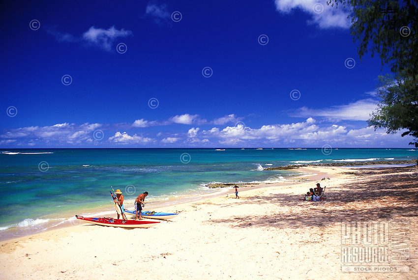 People preparing for kayaking at Waialee beach park on Oahu's north shore
