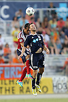 12 June 2013: Carolina's Zack Schilawski (right) and Chivas' Mario de Luna (behind) challenge for a header. The North American Soccer League's Carolina RailHawks hosted Major League Soccer's CD Chivas USA at WakeMed Stadium in Cary, NC in a 2013 Lamar Hunt U.S. Open Cup fourth round game. Carolina won the game 3-1 after extra time.