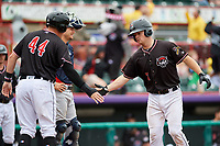 Erie SeaWolves catcher Jake Rogers (7) is congratulated by Josh Lester (44) as he crosses home plate after hitting a home run in the bottom of the fourth inning during a game against the New Hampshire Fisher Cats on June 20, 2018 at UPMC Park in Erie, Pennsylvania.  New Hampshire defeated Erie 10-9.  (Mike Janes/Four Seam Images)