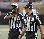 Football - NFL- Seattle Seahawks at St. Louis Rams.NFL professional referee Mike Carey (94, left) laughs and smiles as he talks with line judge Tim Podraza (47, right) in the third quarter at the Rams vs Seahawks game at the Edward Jones Dome in St. Louis. NFL officials had been locked out by the league, until just a few days prior to this game, when the two sides settled their differences and the officials were allowed back to work the games. The Rams defeated the Seahawks, 19-13.