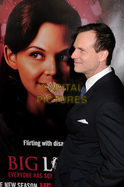 """BILL PAXTON.HBO's """"Big Love"""" 3rd Season Premiere at the Cinerama Dome, Hollywood, California, USA..January 14th, 2009.half length black suit jacket hand touching poster profile .CAP/ADM/BP.©Byron Purvis/AdMedia/Capital Pictures."""
