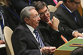 President Raul Castro (L) of Cuba and Cuban Ambassador to the United States José Ramón Cabañas Rodríguez listen to U.S. President Barack Obama addresses the 70th annual United Nations General Assembly at the UN headquarters September 28, 2015 in New York City. Obama will hold bilateral meetings with Indian Prime Minister Narendra Modi and Russian President Vladimir Putin later in the day. <br /> Credit: Chip Somodevilla / Pool via CNP