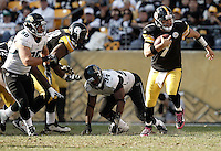 PITTSBURGH, PA - OCTOBER 16:  Ben Roethlisberger #7 of the Pittsburgh Steelers runs with the ball for the first down against the Jacksonville Jaguars during the game on October 16, 2011 at Heinz Field in Pittsburgh, Pennsylvania.  (Photo by Jared Wickerham/Getty Images)