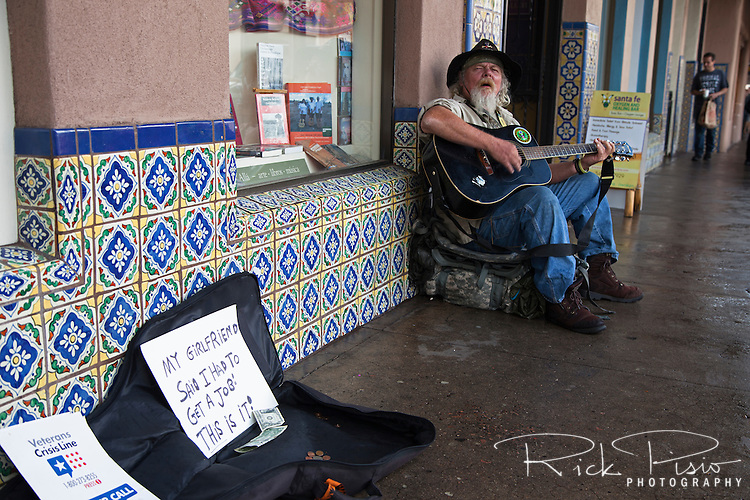 An Army veteran sings outside a shop on Santa Fe's Plaza.