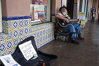 An Army veteran sings outside a shop on Santa Fe's Plaza.