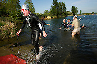 10 MAY 2009 - GRENDON,GBR - Competitors head for transition after finishing the swim - Grendon Triathlon (PHOTO (C) NIGEL FARROW)