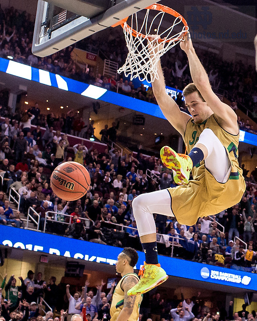 Mar. 28, 2015; Pat Connaughton (24) dunks in the second half of the 2015 NCAA Tournament regional final against Kentucky. (Photo by Matt Cashore/University of Notre Dame)