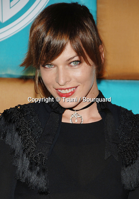 Milla Jovovich arriving at the IN STYLE Party ( Golden Globes ) at the Beverly Hilton in Los Angeles. January 15, 2007.<br /> <br /> eye contact<br /> smile<br /> portrait<br /> headshot