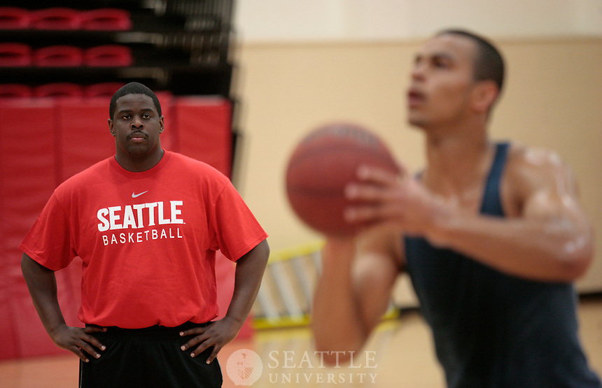 05212009-  Seattle University, Cameron Dollar, head men's basketball coach, working with players, spring work outs