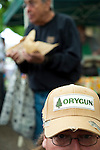 The Portland Farmers' Market on Saturday Mornings in the South Park Blocks offers fresh, organic and locally grown produce, meat, fish and other food products.  Andrew Gallaher of Deleware sports an Orygun hat at the market.