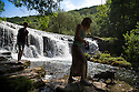 22/07/14 <br /> <br /> Lucy and Ben Plater take their dog find some shade and cool water by Monsal Weir, near Bakewell in the Derbyshire Peak District.<br /> All Rights Reserved - F Stop Press.  www.fstoppress.com. Tel: +44 (0)1335 300098