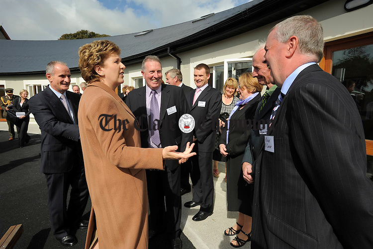 President Mary Mc Aleese and her husband Martin meet with committee members at the official opening of the Ark Creche at Inagh. Photograph by John Kelly.
