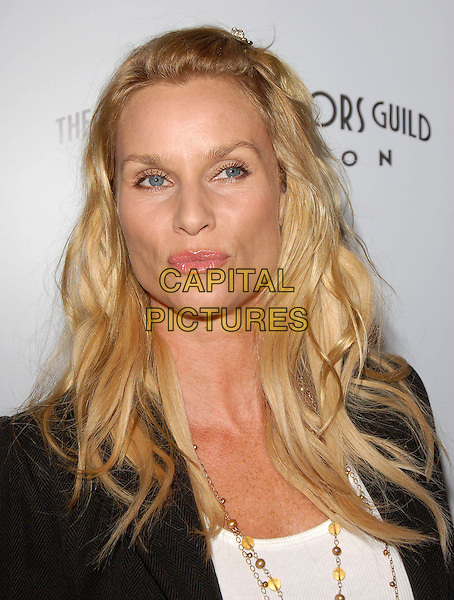 "NICOLLETTE SHERIDAN.attends The TrisStar Pictures' World Premiere of ""Running with Scissors"" held at The Academy of Motion Pictures Arts & Sciences in Beverly Hills, California, USA, October 10th 2006..portrait headshot funny pouting lips Nicolette.Ref: DVS.www.capitalpictures.com.sales@capitalpictures.com.©Debbie VanStory/Capital Pictures"