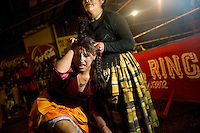 Wrestler Yenifer Dos Caras (fighting name), Anna Luisa Yujra (real name) pulls the hair of 17 year old Alicia Flores (fighting name), Patricia Kaly (real name) during a fight at the Multifuncional building in El Alto. Patricia and Anna are Cholitas, wrestlers of native Aymara descent. When Cholitas fight they wear traditional costume. .