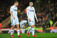 (L-R) George Byers speaks with Connor Roberts of Swansea City during the Sky Bet Championship match between Norwich City and Swansea City at Carrow Road in Norwich, England, UK. Friday 08 March 2019