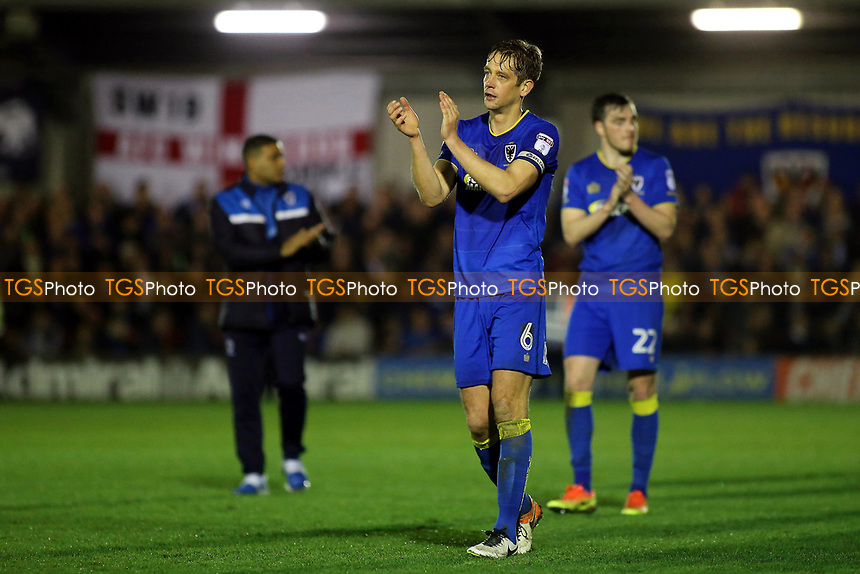 AFC Wimbledon captain, Paul Robinson, applauds the fans at the end of the match as the players walk around the pitch to celebrate their historic victory during AFC Wimbledon vs MK Dons, Sky Bet EFL League 1 Football at the Cherry Red Records Stadium on 14th March 2017