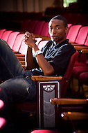 Hip Hop Producer 9th Wonder sits in an old theatre in his home town of Durham North Carolina.