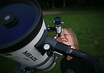 Child looking through a telescope, Holland