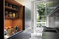 Details such as doors that slide back into the kitchen units are idea for a narrow space where tradtional doors would be a hinderance
