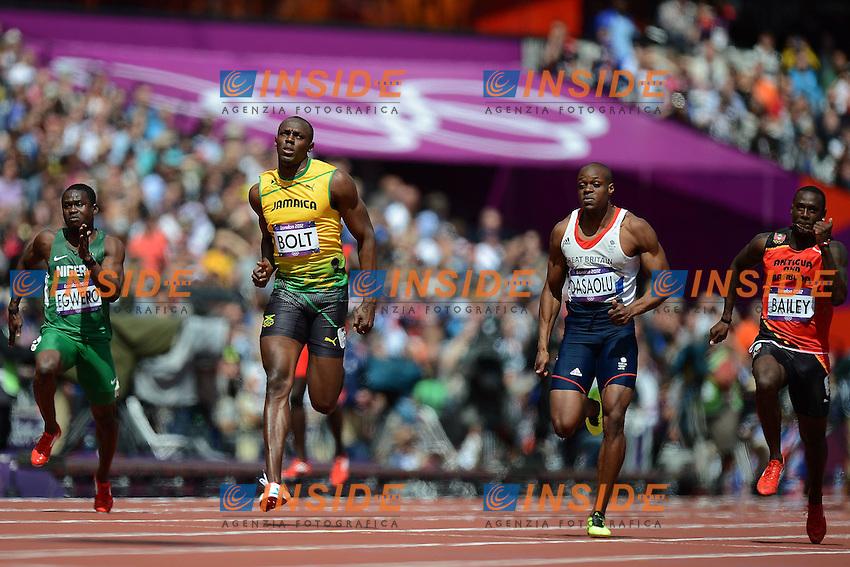 Usain Bolt Jamaica e James Dasaolu Gran Bretagna.London 04/08/2012 .London 2012 Olympic games  - Men s 100m Heat of Athletics - Olimpiadi Londra 2012 - 100m Uomini Atletica.Olympic Stadium.Foto Imago / Insidefoto.ITALY ONLY..