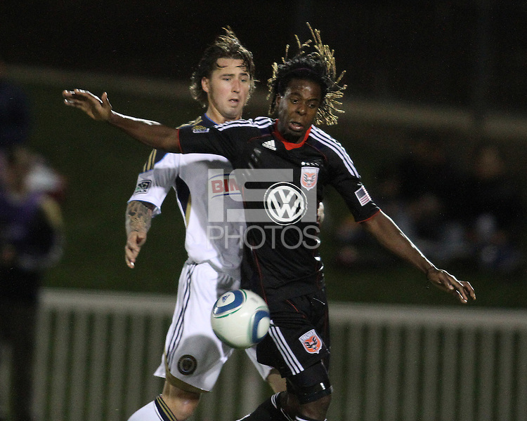Joseph Ngwenya(11) of D.C. United shields the ball from Danny Califf(4) of the Philadelphia Union during a play-in game for the US Open Cup tournament at Maryland Sportsplex, in Boyds, Maryland on April 6 2011. D.C. United won 3-2 after overtime penalty kicks.