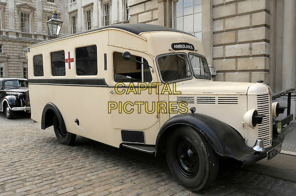 Ambulance <br /> Filming on the set of 'Fleming' where Dominic Cooper stars as Ian Fleming, Central London, England.<br /> 29th June 2013<br /> tv mini series gv general view car truck bus cross door open<br /> CAP/IA<br /> &copy;Ian Allis/Capital Pictures