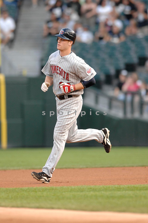 JUSTIN MORNEAU, of the Minnesota Twins  , in action during the  Twins  game against the Chicago White Sox in Chicago, IL  on July 6,  2007...Twins  win 20-14...DAVID DUROCHIK / SPORTPICS.