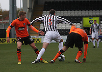 Gavin Gunning (right) and Lee Mair tangle as Stuart Armstrong tackles  in the St Mirren v Dundee United Clydesdale Bank Scottish Premier League match played at St Mirren Park, Paisley on 27.10.12.