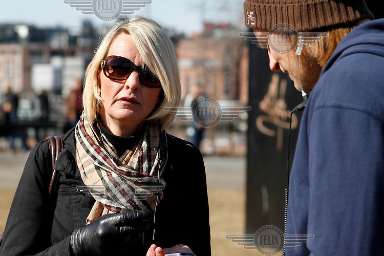 Lena Andreassen from Norwegian Defence League..Norwegian Defence League held their first rally in Oslo on April 9, 2011. Only a handuful of people turned up, and NDL were outnumbered by media representatives. .In another part of town opponents held a counter demonstration. A man was alleged to have have called rasist remarks and hit a woman, and was subsequently beaten by protesters. the man was eventually rescued by a plain clothed police man.