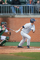 Roman Collins (15) of the Florida Atlantic Owls follows through on his swing against the Charlotte 49ers at Hayes Stadium on March 14, 2015 in Charlotte, North Carolina.  The Owls defeated the 49ers 8-3 in game one of a double header.  (Brian Westerholt/Four Seam Images)