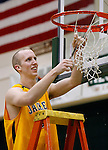 SPEARFISH, SD - MARCH 1, 2009 --  Luke Enos of Black Hills State cuts his piece of the net down after the Yellow Jackets defeated Minot State University for the Dakota Athletic Conference Championship Sunday afternoon in Spearfish, S.D. (Photo by Dick Carlson/Inertia)