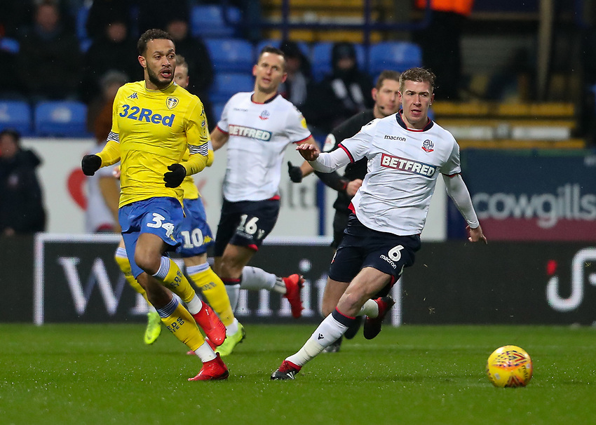 Bolton Wanderers' Josh Vela competing with Leeds United's Lewis Baker<br /> <br /> Photographer Andrew Kearns/CameraSport<br /> <br /> The EFL Sky Bet Championship - Bolton Wanderers v Leeds United - Saturday 15th December 2018 - University of Bolton Stadium - Bolton<br /> <br /> World Copyright © 2018 CameraSport. All rights reserved. 43 Linden Ave. Countesthorpe. Leicester. England. LE8 5PG - Tel: +44 (0) 116 277 4147 - admin@camerasport.com - www.camerasport.com